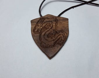 Dragon on shield engraved wooden pendand