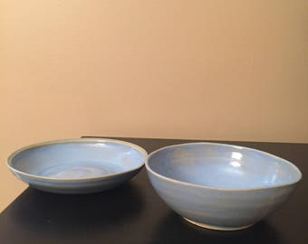 2 light blue bowls being sold as a pair