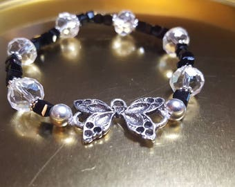 Butterfly beaded bracelet, black and clear