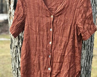 rust/burnt orange button down short sleeve/sleeved blouse with side slits size large