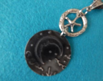 Steel embossed pendant with moon and star