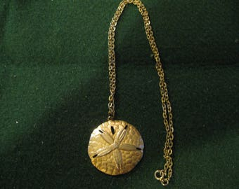 Gold Tone Sand Dollar Necklace with a 12'' Chain