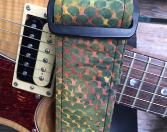 Handmade guitar strap featuring green and blue circles.