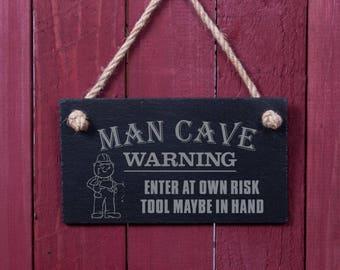 Funny sign: Man cave WARNING (FAD1057)