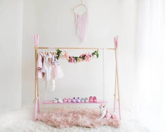 Pink clothing and shoe rack