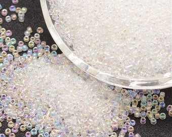 lot 10g 8/0 seed beads: 2.8-3.2 mm rainbow clear