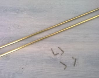 286) pair of little rods with pitons brass