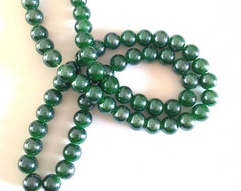10 T32 iridescent green glass beads