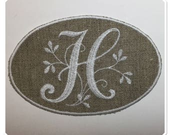 "Monogram Letter ""H"" white embroidery on linen"
