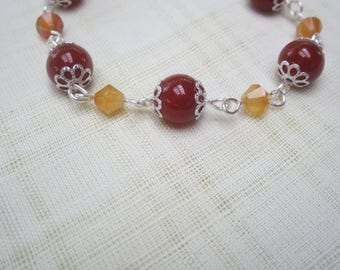 Silver plated necklace with carnelian beads and alternating bicone beads