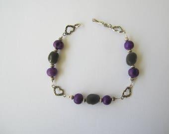 Purple bracelet in zanzibar and acai seeds