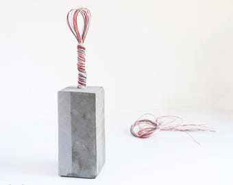 Handmade concrete doorstop-bookend