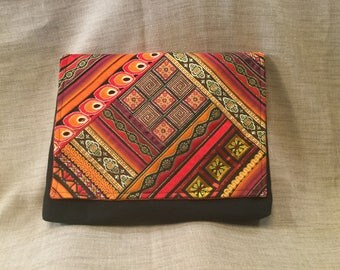 Bohemian clutch, large black pouch and orange reds.