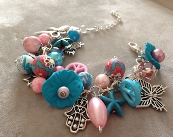 Trimmed blue and pink charm bracelet beads, polymer clay.