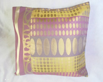 Plum, bronze green pillow cover and Brown.