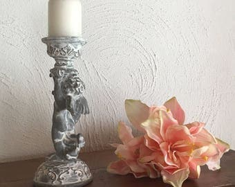 Candlestick with cherub nicely dressed in grey and white