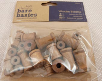 Bag of small wooden spools