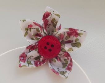 Red fabric flower brooch.