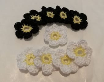 Applique crochet cotton flowers of yellow, black and white