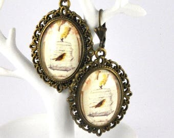 Vintage caged bird cabochon earrings