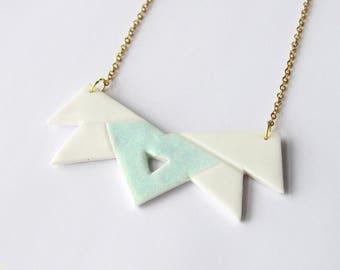Bib necklace white triangle polymer clay figure