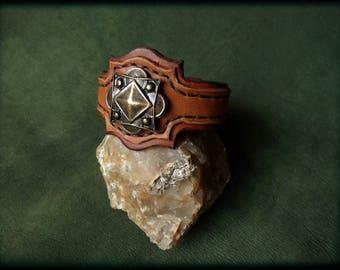 Leather Bracelet, decorated by metal motif, hand stitching.