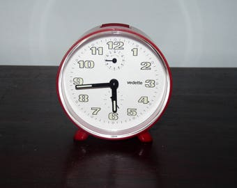 Mechanical alarm clock featuring Red 80's / 90, works very well.