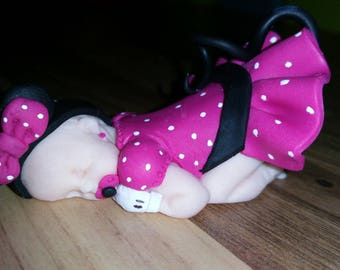 baby with shoulder pads and gloves only minni panties with polka dots