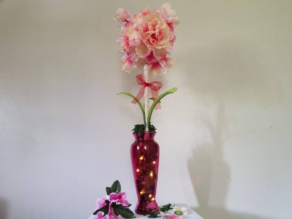 Pink light up floral and vase topiary centerpiece arrangement