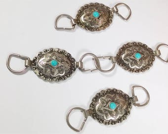 Set of 4 oval medallions with turquoise bead in the Center