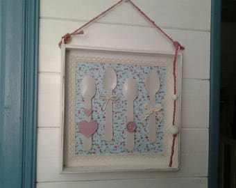 White wooden frame decorated wooden spoons