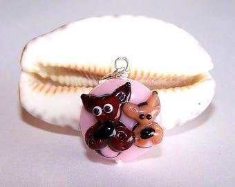 Doggies glass bead pendant