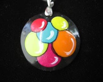 Pop pendant with multicolored circles on a black cord