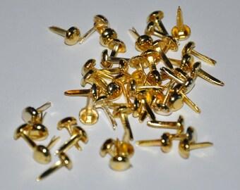 Set of 100 round brads, gold