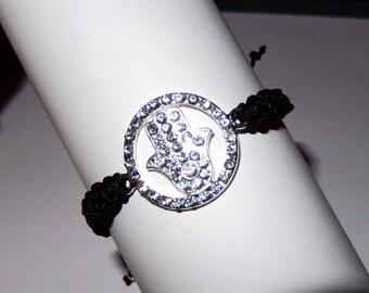 Black macrame bracelet and charm hand of Fatima with multitude of rhinestones