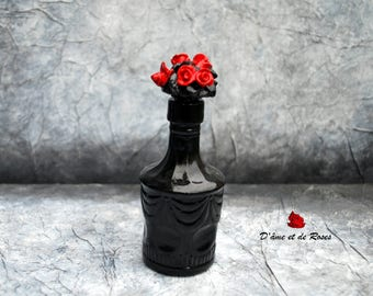Baroque bottle with 4 Red Roses