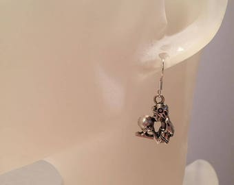Showy skeleton earrings