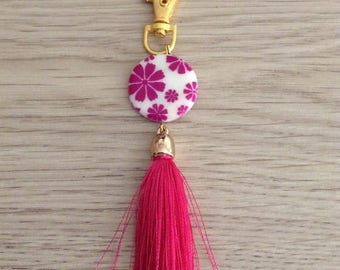 Jewelry bag composed of a Pearl mother of Pearl disc and tassel