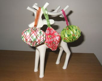Trio of origami Christmas ornaments