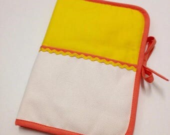 Health book has cross-stitch, 100% cotton yellow fabric.