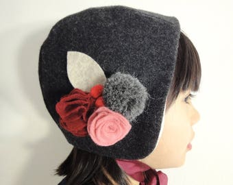 Wool Bonnet with felt flowers and pompom for babies and girls.