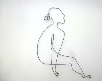 Wire sculpture: young woman seated