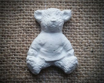 Decorative little bear in raw cast