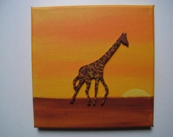 African giraffe with wooden table.
