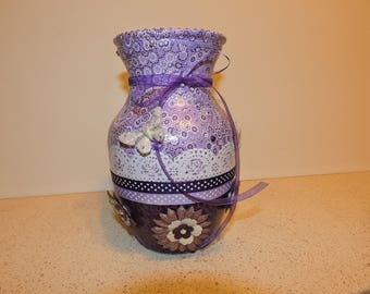 Purple romantic vase decorated with flowers and butterflies