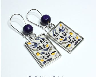 Bird motif earrings
