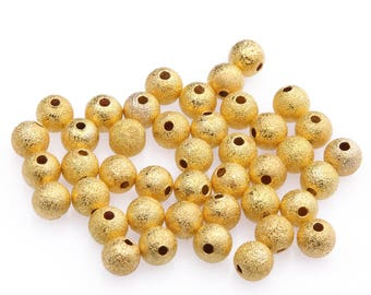 4 mm / 100 copper stardust gold beads
