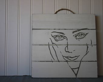 Womans face sign