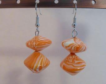 Stacking tops acrobats orange white earrings