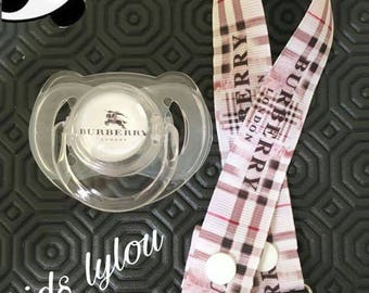 The brand Burberry London matching pacifier pacifier